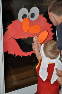 Sesame Street Birthday Party - pin the nose on Elmo