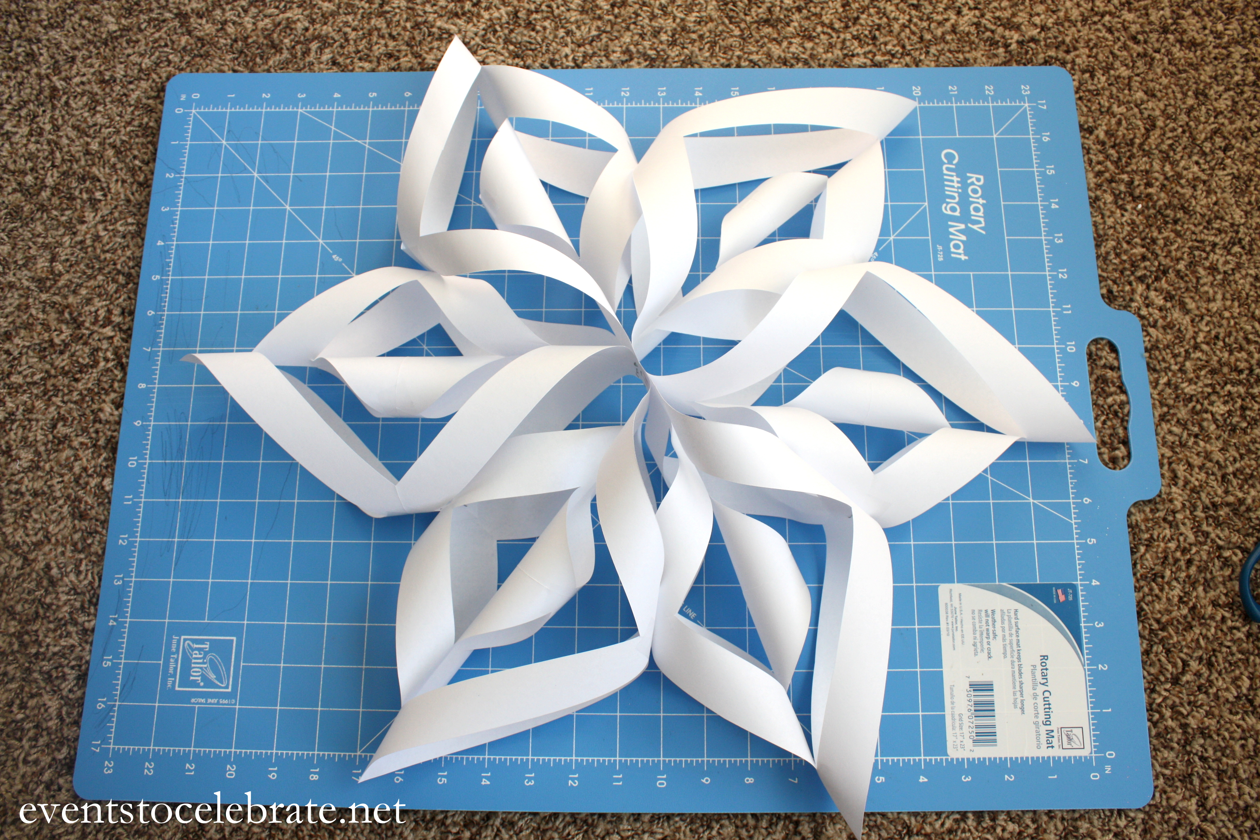 How to make a 3d paper snowflake events to celebrate for Diy paper snowflakes 3d