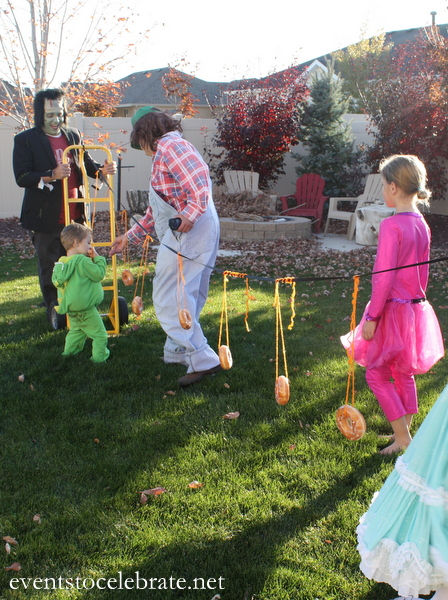 Halloween Party Activities - Donuts on a String - Events To Celebrate