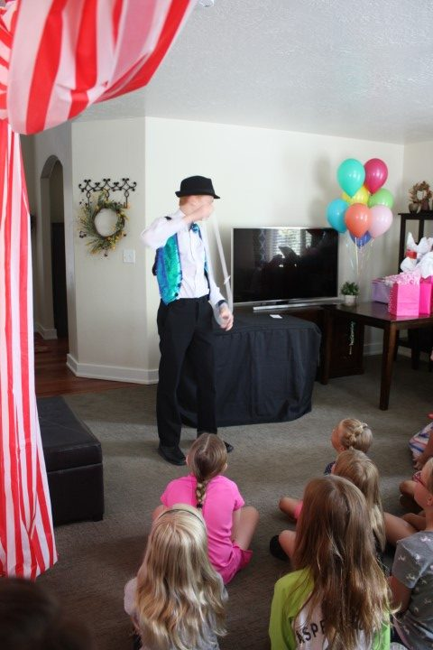 magician for a carnival themed birthday party